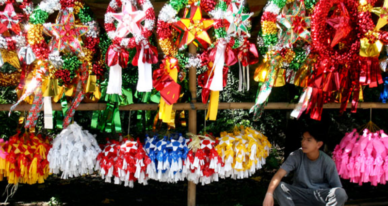 Filipino man with christmas decorations