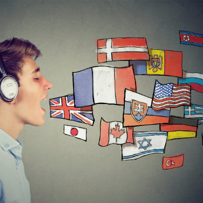 La llengua pot reflectir una ... inlingua Andorra blog post. Boy with headphones opens his mouth. Flags from around the world come out as cartoons