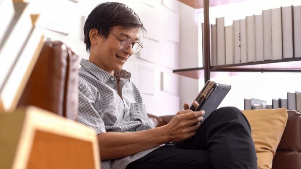 Adult student on opad and smartphone