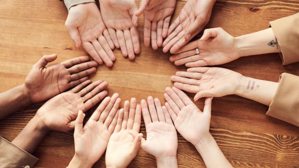 Group of hands together inlingua Andorra inclusion department inclusive learning