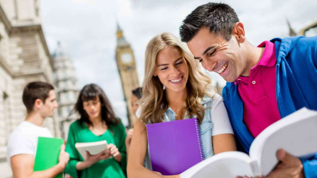 Man and woman study abroad to learn new languages inlingua andorra